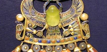 This image shows Tutankhamun's pectoral with a scarab carved from the Libyan Desert Glass. Image credit: Jon Bodsworth.
