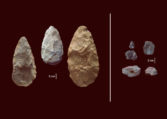 The first evidence of human life in the Olorgesailie Basin comes from about 1.2 million years ago. For hundreds of the thousands of years, people living there made and used large stone-cutting tools called handaxes (left). According to three new studies, early humans in East Africa had -- by about 320,000 years ago -- begun using color pigments and manufacturing more sophisticated tools (right) than those of the Early Stone Age handaxes, tens of thousands of years earlier than previous evidence has shown in eastern Africa. The sophisticated tools (right) were carefully crafted and more specialized than the large, all-purpose handaxes (left). Many were points designed to be attached to a shaft and potentially used as projectile weapons, while others were shaped as scrapers or awls. Image credit: Human Origins Program, Smithsonian.