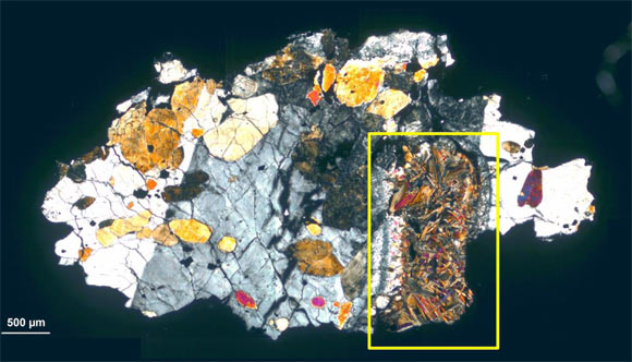Thin section of ALH-77005: poikilitic texture of olivine with pyroxene cumroxene grains, the studied molten pocket (rectangle) composed mainly of olivine. Image credit: Gyollai et al, doi: 10.1515 / astro-2019-0002.