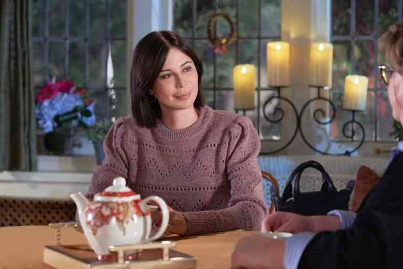 GOOD WITCH Season 7 Episode 4 The Middleton Exchange tradition is revived when Joy makes a discovery in Martha's office. Sam's upcoming surgery on a superstar basketball player doesn't go as planned.  Photo: Catherine Bell  Credit: ©2021 Crown Media United States LLC/Photographer: Peter Stranks