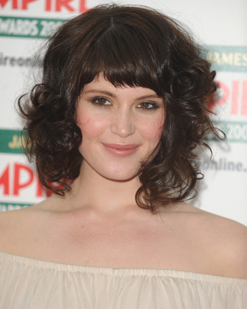 Gemma Aerton with curly hair and bangs