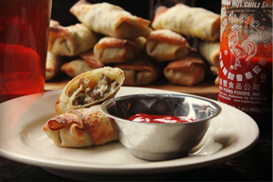 Cheesesteak eggrolls with Sriracha ketchup