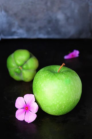 green apple with pink flower