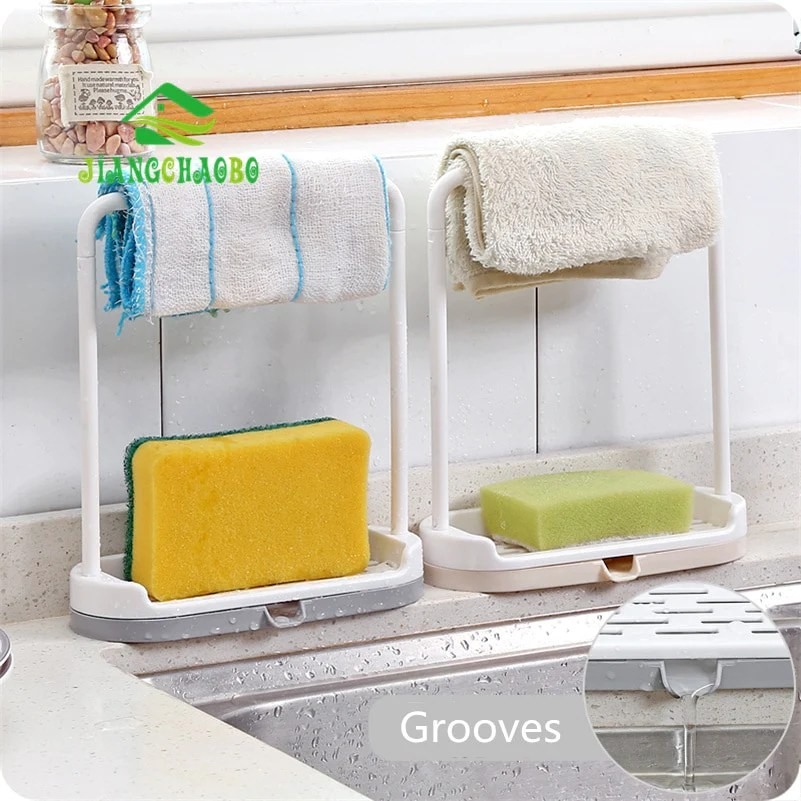 kitchen counter rack backsplash subway tile countertop towel and sponge with drain
