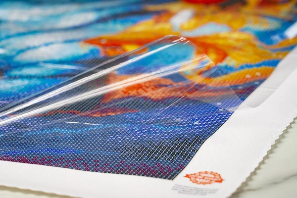 Applicator tool placing purple diamond on canvas