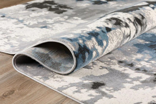 keep area rugs from slipping on carpet