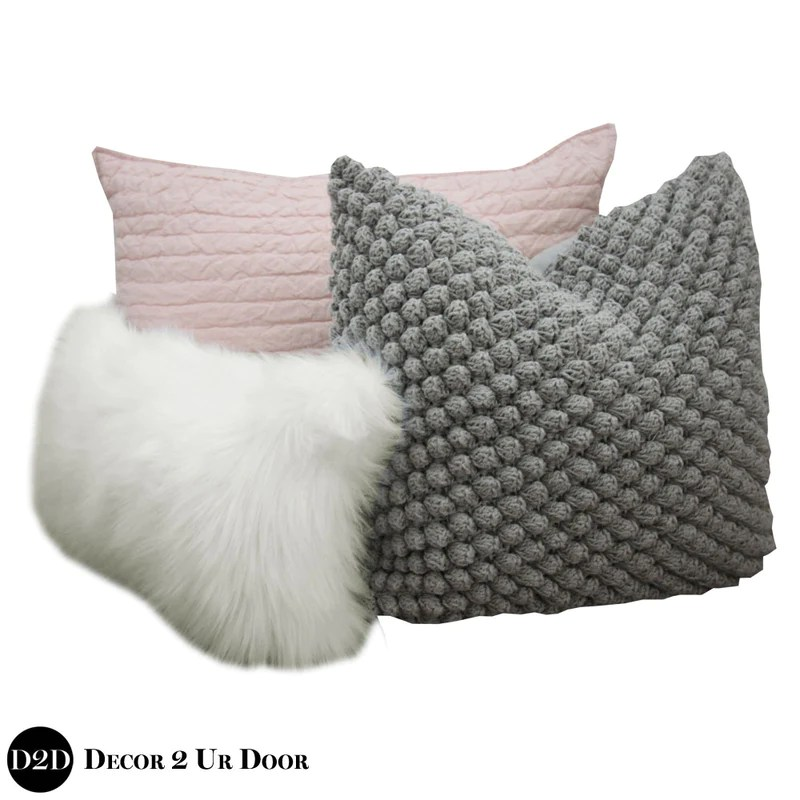blush pink grey faux fur pillow pile