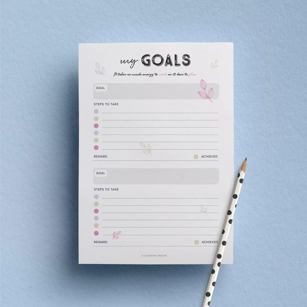 Clementine Creative goals template on a blue surface with a pencil