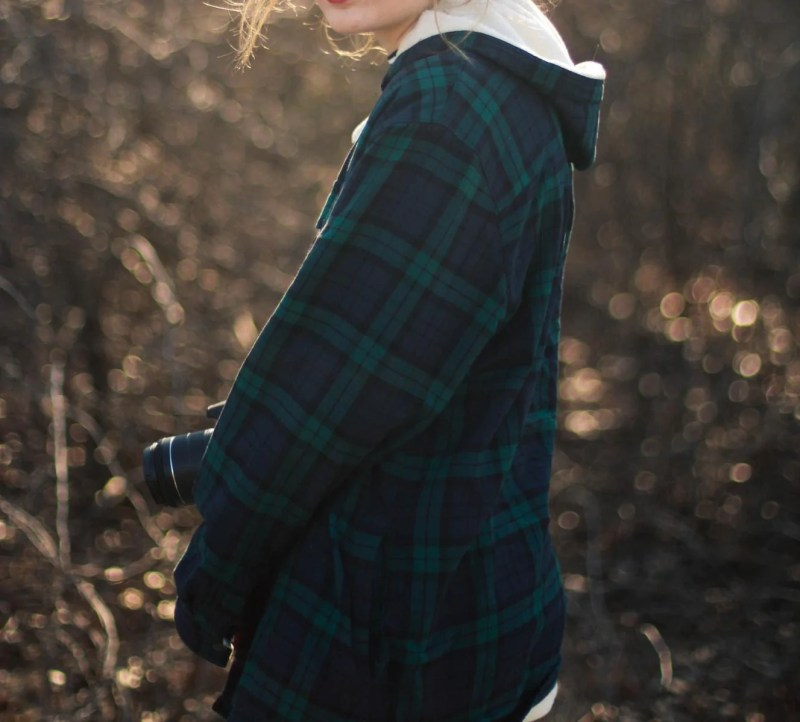 Image showing a woman wearing a plaid hoodie which is a trending product to sell in 2020