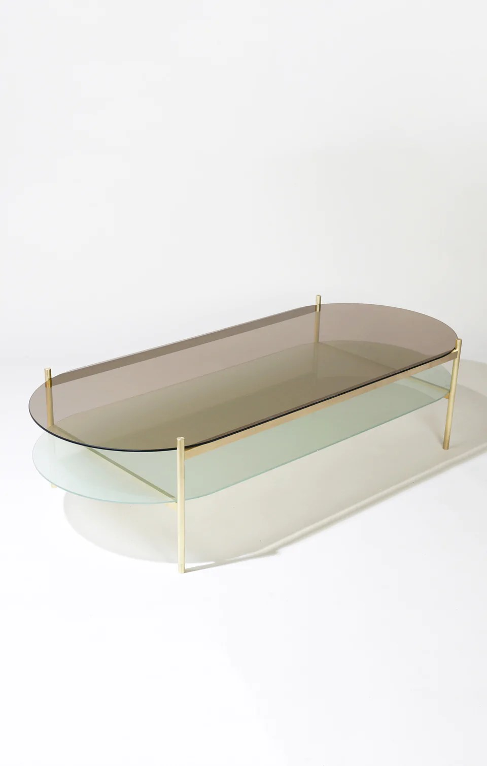 duotone pill coffee table brass frame bronze glass frosted glass