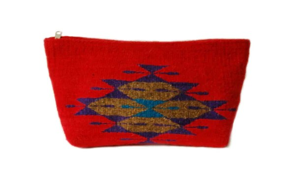 The richly hued Tribal Wool Clutches are handwoven from naturally dyed wool using traditional weaving patterns. Handcrafted by Josefina and her husband Paco in Teotitlán, Mexico, the manufacture of these clutches is both ethical and eco-friendly, making it a great bag from start to finish.
