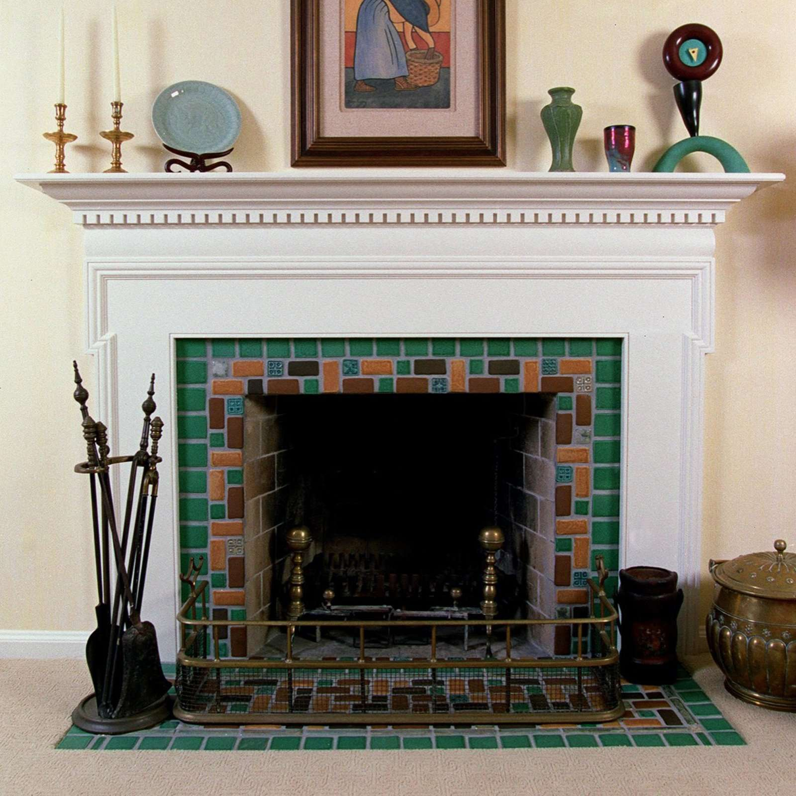 green and brown fireplace pewabic