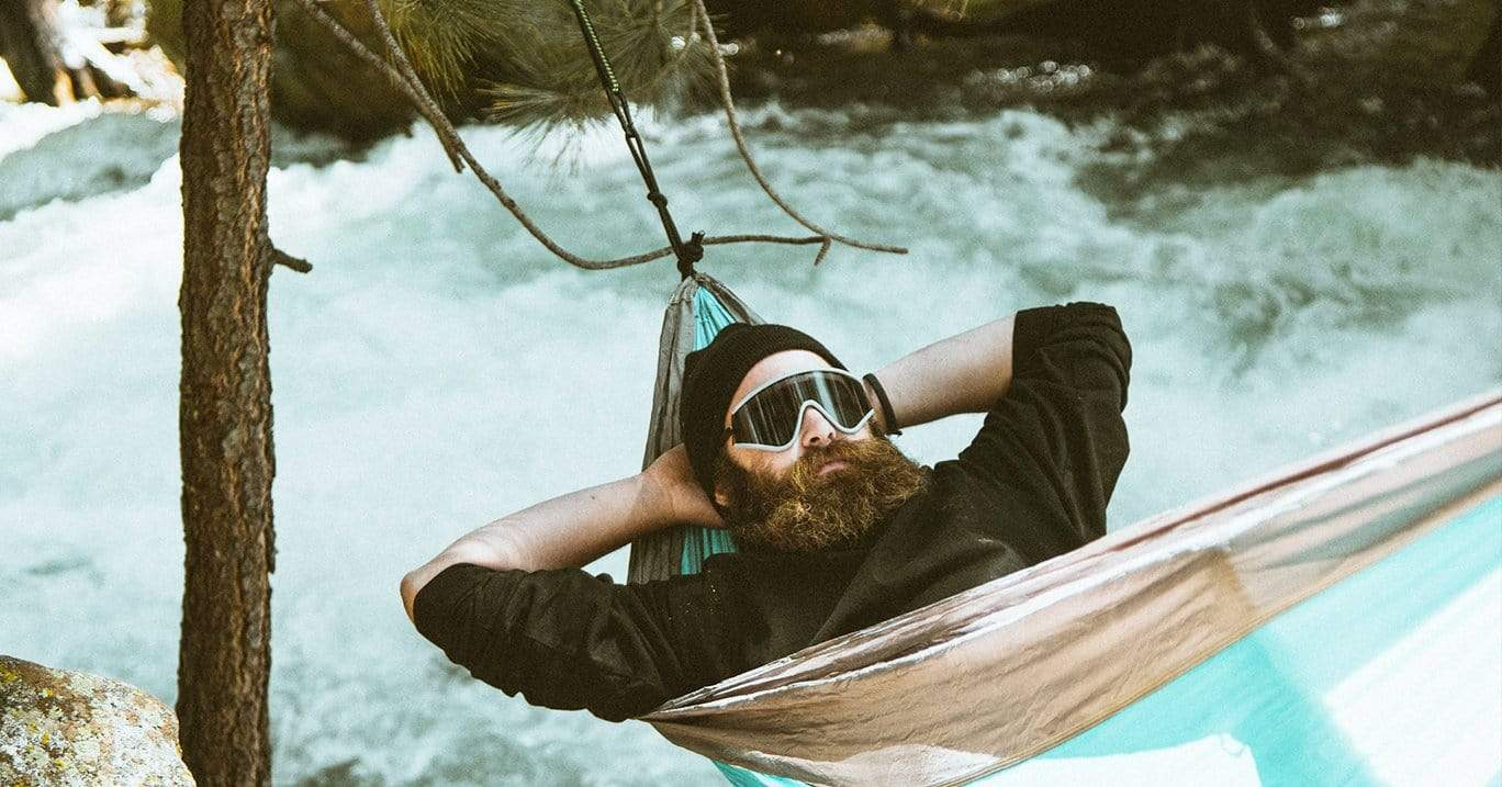 swing chair benefits blames high tray hammocks hammock accessories man with a beard and skiing goggles on takes nap in camping next