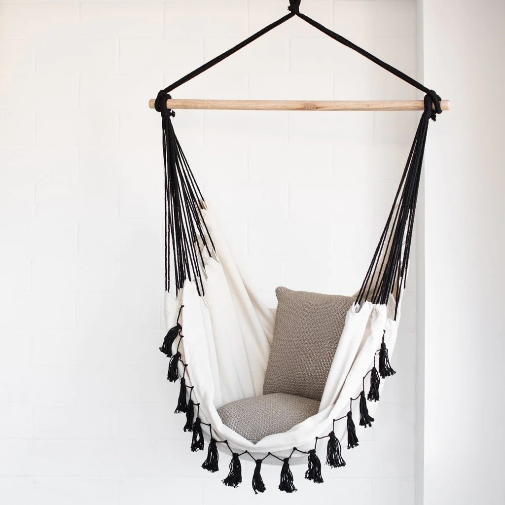 black hanging chair for bedroom ikea poang replacement parts hammock soho cream with tassels ivory and deene