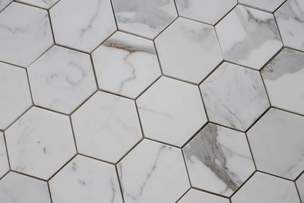 https www rockypointtile com products 4 hexagon calacatta gold polished marble mosaic tiles