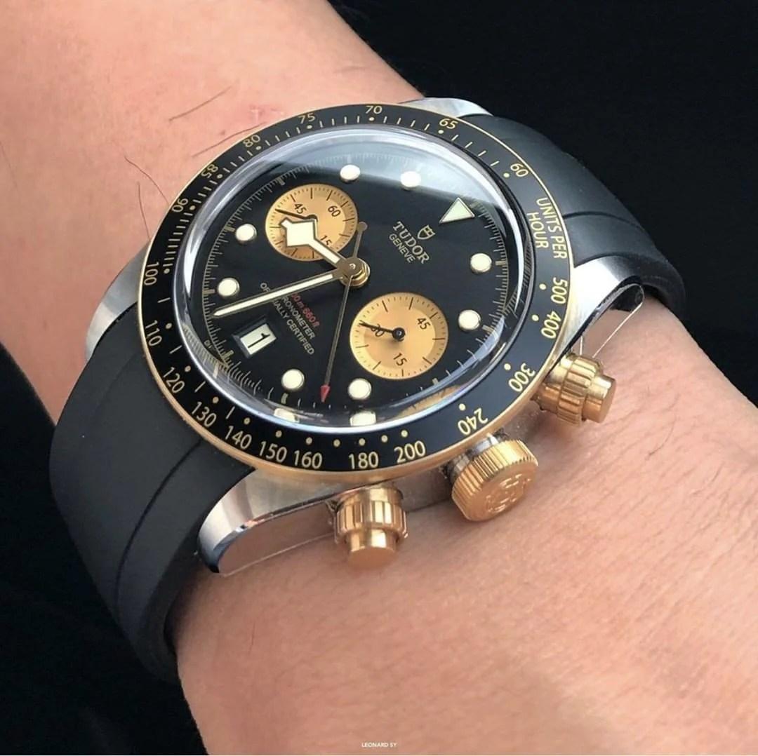 gold and black tudor chrono on black rubber strap