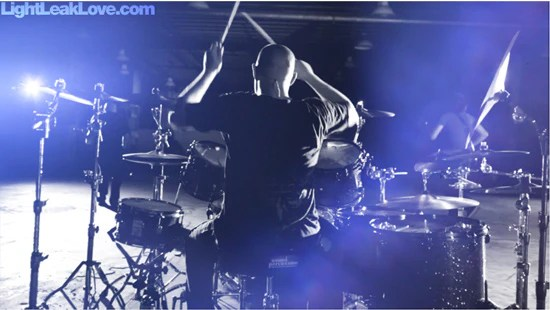 drummer with light leak effects being used on video footage