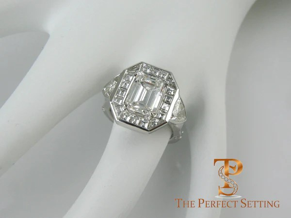 Emerald Cut Diamond Engagement Ring With Baquette Halo