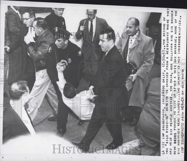 1957 Press Photo Silk Stocking Bandit Removed From Crime