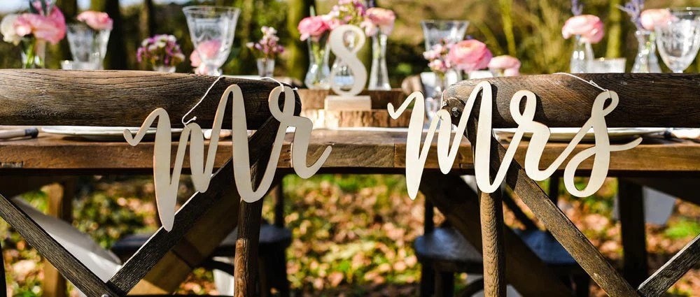 mr and mrs chair signs revolving manufacturers in kolkata wedding backs willow hearts ribbons hessian sashes