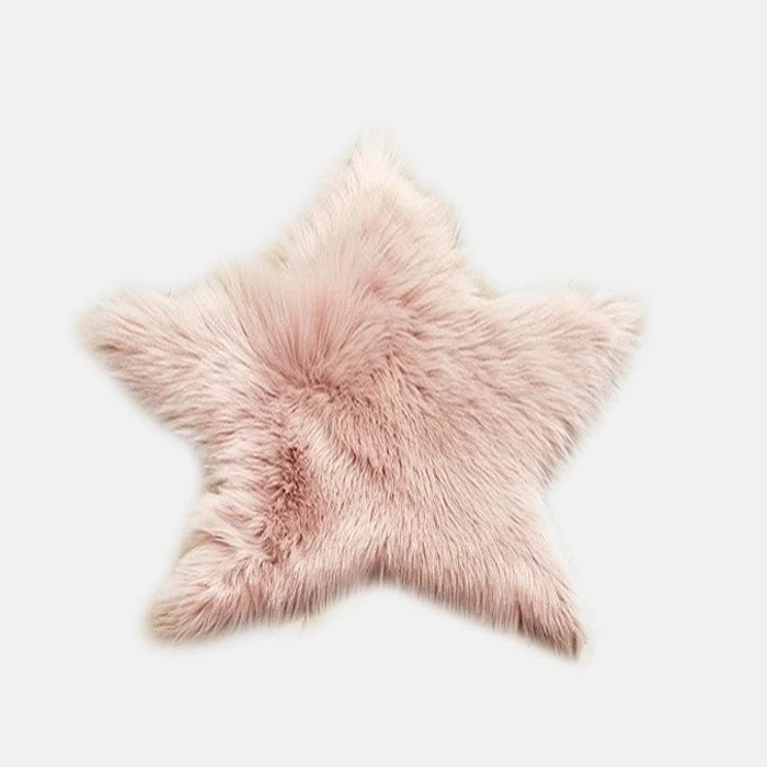 tapis etoile en fourrure rose poudre