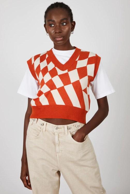 Orange and ivory psychedelic intarsia sweater vest