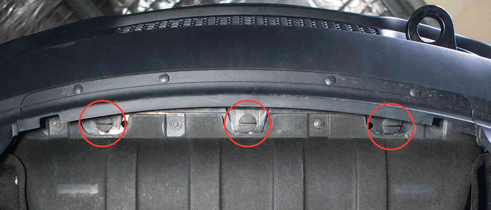 small resolution of looking from underneath the lower fascia insert the 3 quarter turn fasteners through the plastic tabs on the air baffle and into the slots in the