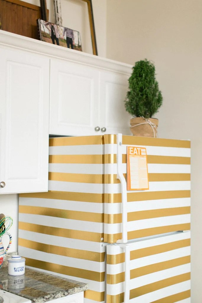 7 Unexpected Things to Stripe Using Easy Stripe by @wallsneedlove | DIY Gold Striped Fridge