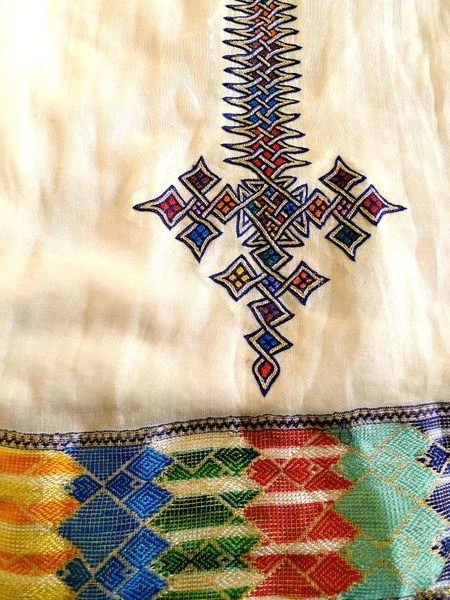 White sleeveless traditional Ethiopian dress with multicolored cross  FTWWL