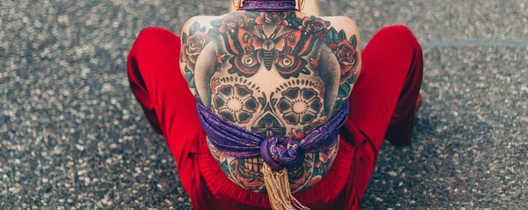 Woman with a Calavera Back Tattoo