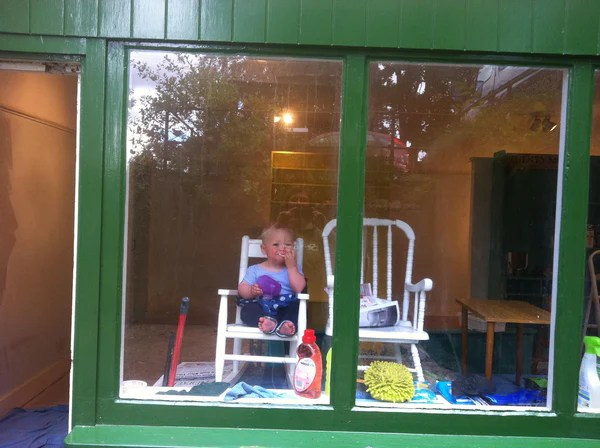 Baby in a shop window