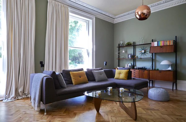 mid century modern furniture in victorian house