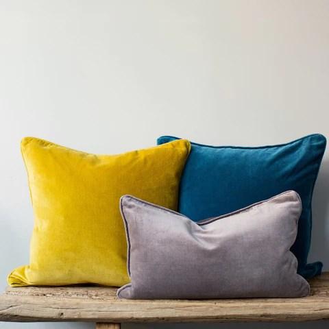 Velvet cushion with piping  HomeAddress