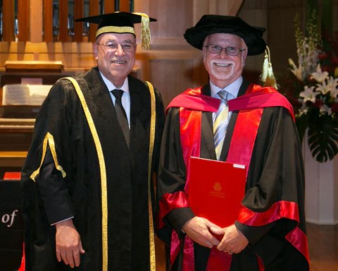 Dr Andrew Gooley, Trajan Chief Scientific Officer (right), receiving the award from Prof Mike Calford, Acting Vice-Chancellor, UTAS (left).