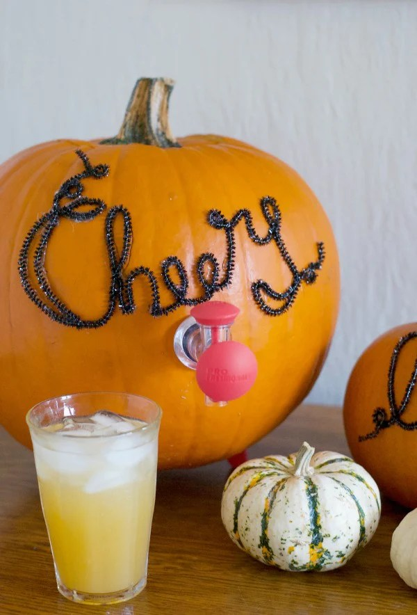 Click through to see how I made this fun pumpkin beverage dispenser for Halloween parties | SatsumaDesigns.com #party #Halloween