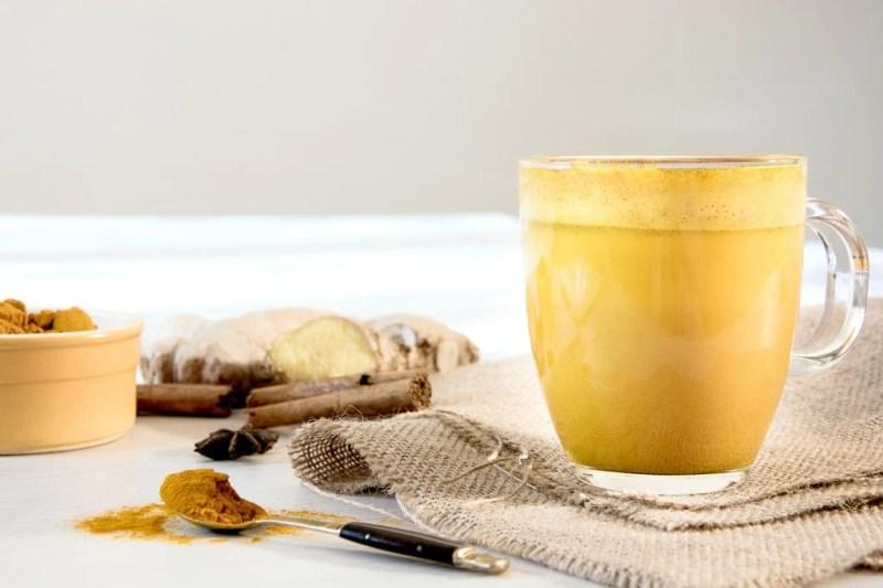 turmeric golden milk in glass mug