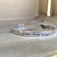 """Courage, dear heart."""