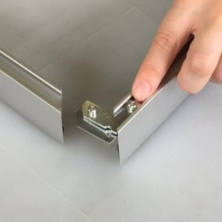 Insert a bottom L corner plate (Letter A with no screws) and a top L corner plate (Letter B with screws) into the back channel at the end of one frame side.