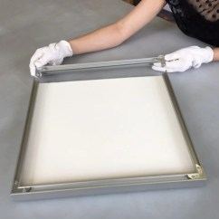 Insert corner plates at both ends of the last frame side then slide it on. Flip the frame over and ensure all the corners meet well and are tight.