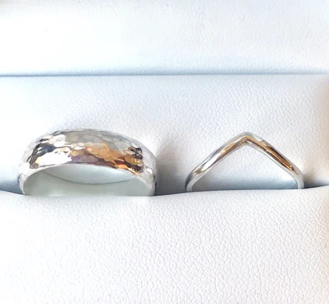 Wide hammered wedding ring band 6mm and narrow wishbone shaped wedding ring 2.3mm. Both D shaped