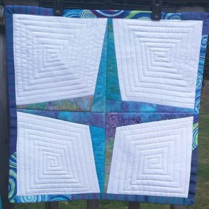Rising Star - Quilted Table Topper @ BayStitches