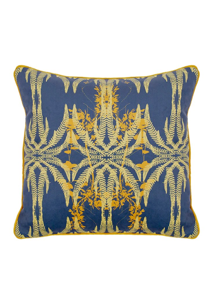jutias blue and yellow cotton velvet cushion bathed in the sun