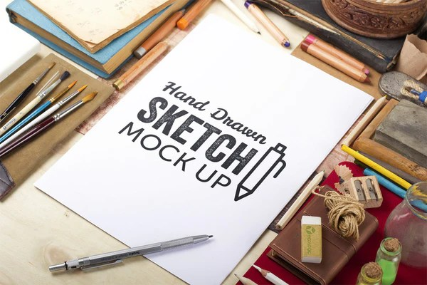 Free Hand Drawn Sketch Mockup with a Man Drawing  CreativeBooster