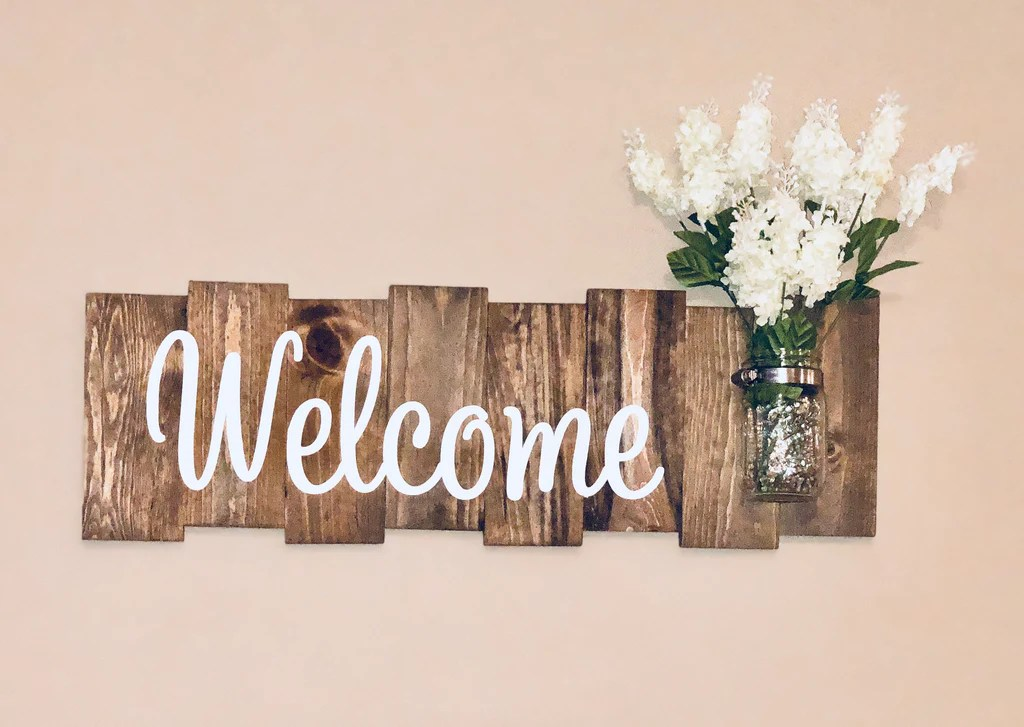 rustic welcome sign with