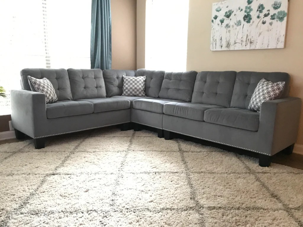 grey tufted sectional with nail head trim