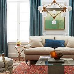 Mixing Furniture Styles Living Room Green And Brown Ideas Tips For Traditional Modern Urban Rhythm With A Fireplace Cream Sofa Turqouise Curtains Decorative Chandelier