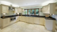 How To Paint Your Kitchen Cabinets Without Sanding or ...