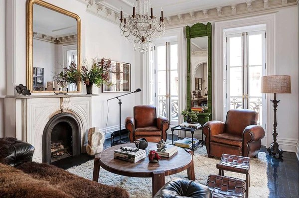 four club chairs in living room big lots furniture sets a complete guide to french leather vintage chez pluie roman and williams pair of with louis philippe mirror chandelier