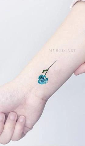Small Rose Tattoo On Hand For Girls