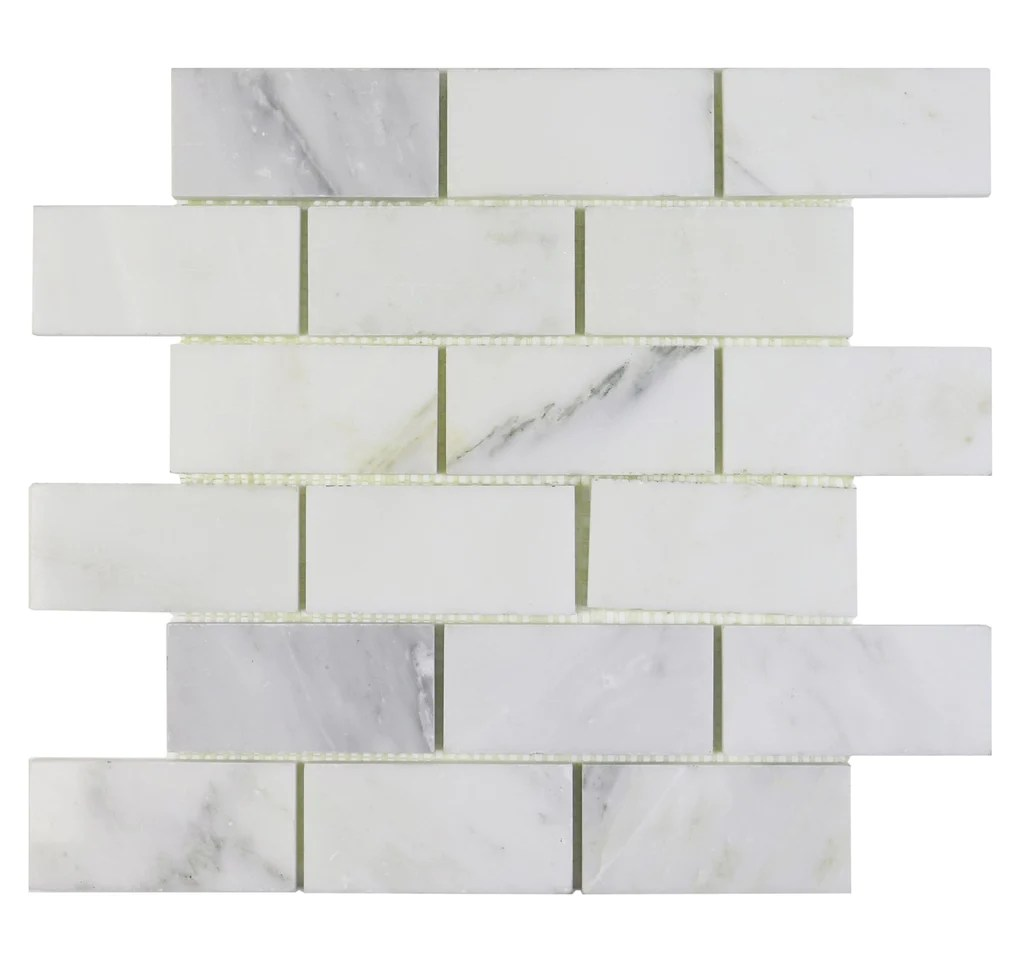 calacatta gold marble mosaic tile in 2x4 mini brick subway tiles pattern polished